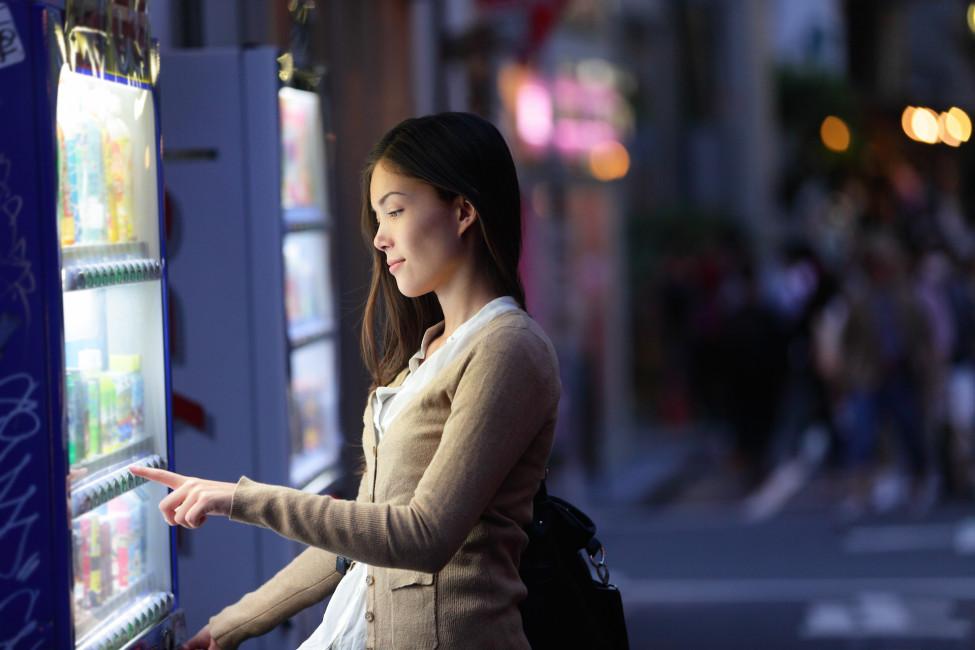 Woman using a vending machine